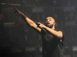 FILE - In this Oct. 3, 2015, file photo, Drake performs at the Austin City Limits Music Festival in Zilker Park in Austin, Texas. Spotify announced its end-of-the-year list Tuesday, Dec. 1, 2015,  and said Drake was the most streamed artist of the year globally, earning 1.8 billion streams in 2015. Rihanna was the year¿s most streamed female performer with 1 billion streams, while Major Lazer¿s ubiquitous hit, ¿Lean On,¿ was the most streamed song of the year with 540 million streams. (Photo by Jack Plunkett/Invision/AP, File)