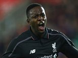 SOUTHAMPTON, ENGLAND - DECEMBER 02:  Divock Origi of Liverpool celebrates as he scores their fourth goal during the Capital One Cup quarter final match between Southampton and Liverpool at St Mary's Stadium on December 2, 2015 in Southampton, England.  (Photo by Clive Rose/Getty Images)
