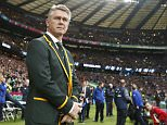 South Africa's coach Heyneke Meyer walks onto the field before the Rugby World Cup semifinal match between New Zealand and South Africa at Twickenham Stadium in London, England.   Saturday, Oct. 24, 2015. (AP Photo/Alastair Grant)