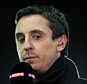 26th January 2015 - Barclays U21 Premier League - Manchester United v Liverpool - Sky Sports pundit Gary Neville holds the microphone - Photo: Simon Stacpoole / Offside.