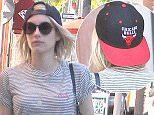 Emma Roberts grabs Pressed Juicery in Beverly Hills, CA.  Pictured: Emma Roberts Ref: SPL1188448  021215   Picture by: Be Like Water Production  Splash News and Pictures Los Angeles: 310-821-2666 New York: 212-619-2666 London: 870-934-2666 photodesk@splashnews.com