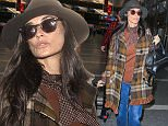 Minimal make up Demi Moore bunded up in plaid jacket, hat and glasses flying to Paris from LAX in Los Angeles , CA December 2, 2015 X17online.com