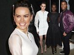 """NEW YORK, NY - DECEMBER 02:  (L-R) Actors Daisy Ridley, John Boyega, and Lupita Nyong'o pose with Parkers Star Wars-inspired look for the Star Wars """"Force 4 Fashion"""" Event on Dec. 2 at the Skylight Modern in NYC. Top designers showcased bespoke looks inspired by characters from Star Wars: The Force Awakens that will be auctioned off for Bloomingdales holiday charity.  (Photo by Larry Busacca/Getty Images for Disney Consumer Products)"""