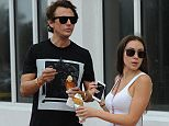 Jonathan Cheban and girlfriend Anat Popovsky get ice cream in Miami Beach. The couple were seen walking to a pop up art ice cream shop set up at The Setai Hotel in Miami Beaech for Art Basel.  Pictured: Jonathan Cheban and girlfriend Anat Popovsky  Ref: SPL1188313  021215   Picture by: Jason Winslow / Splash News  Splash News and Pictures Los Angeles: 310-821-2666 New York: 212-619-2666 London: 870-934-2666 photodesk@splashnews.com