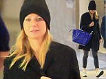 Gwyneth Paltrow arrives at LAX exhausted and MAKE UP FREE after a red eye flight from New York City. Gwyneth was in the Big Apple celebrating the opening of NYC Goop shop. December 3, 2015 X17online.com EXCLUSIVE