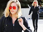 Khloe Kardashian is sexy in her all black attire and red shades when hitting the gym in Sherman Oaks. December 2, 2015 X17online.com