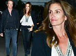 Please contact X17 before any use of these exclusive photos - x17@x17agency.com   Happy couple Cindy Crawford and Rande Gerber are arm in arm as they step out for a romantic dinner at Giorgio Baldi. December 1, 2015 X17online.com EXCLUSIVE