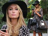 EXCLUSIVE: Paris Hilton takes her dog for a shopping trip in Bal Harbour.\n\nPictured: Paris Hilton\nRef: SPL1186023  011215   EXCLUSIVE\nPicture by: Photopress Miami / Splash News\n\nSplash News and Pictures\nLos Angeles: 310-821-2666\nNew York: 212-619-2666\nLondon: 870-934-2666\nphotodesk@splashnews.com\n
