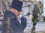 EXCLUSIVE: Tom Hardy takes a sandwich break in his top hat and black overcoat costume while filming BBC period drama 'Taboo' in the English countryside. The British hard man actor was seen puffing on an E-Cigerette while talking to crew between takes.   Pictured: Tom Hardy Ref: SPL1180653  021215   EXCLUSIVE Picture by: Deano / Splash News  Splash News and Pictures Los Angeles: 310-821-2666 New York: 212-619-2666 London: 870-934-2666 photodesk@splashnews.com