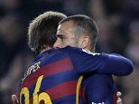 FC Barcelona's Sandro, right, reacts with teammates after scoring against Villanovense during a Copa del Rey soccer match at the Camp Nou stadium in Barcelona, Spain, Wednesday, Dec. 2, 2015. (AP Photo/Manu Fernandez)