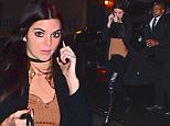 EXCLUSIVE: Kendall Jenner was spotted leaving a NYC Photoshoot on Wednesday. She wore knee high leather boots while chatting on the phone . She wore a black choker and a tan colored shirt as she stepped into the rainy night.\n\nPictured: Kendall Jenner\nRef: SPL1188254  021215   EXCLUSIVE\nPicture by: 247PAPS.TV / Splash News\n\nSplash News and Pictures\nLos Angeles: 310-821-2666\nNew York: 212-619-2666\nLondon: 870-934-2666\nphotodesk@splashnews.com\n