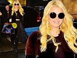 EXCLUSIVE: Jessica Simpson bears her midriff when stepping out with a multicolored purse paired with a very expensive Fendi yellow fur ball charm in rainy NYC\n\nPictured: Jessica Simpson\nRef: SPL1189099  031215   EXCLUSIVE\nPicture by: XactpiX/Marquez/Splash News\n\nSplash News and Pictures\nLos Angeles: 310-821-2666\nNew York: 212-619-2666\nLondon: 870-934-2666\nphotodesk@splashnews.com\n