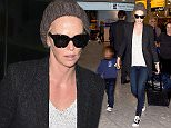 EXCLUSIVE: Charlize Theron and son Jackson Theron are seen arriving at heathrow airport london\n\nPictured: Charlize Theron ,Jackson Theron\nRef: SPL1188052  041215   EXCLUSIVE\nPicture by: Neil Warner /Splash News\n\nSplash News and Pictures\nLos Angeles: 310-821-2666\nNew York: 212-619-2666\nLondon: 870-934-2666\nphotodesk@splashnews.com\n