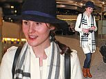Picture Shows: Michelle Dockery  December 04, 2015    'Downton Abbey' actress Michelle Dockery is seen leaving Heathrow Airport in London, England.    The star, who was wearing a knee-length white coat, a black fedora, denim jeans, brown ankle boots and a Burberry scarf - was on her way to New York City from Heathrow's Terminal 5.    **Min £200 Web/Online Set Usage Fee**    Exclusive - All Round  WORLDWIDE RIGHTS    Pictures by : FameFlynet UK © 2015  Tel : +44 (0)20 3551 5049  Email : info@fameflynet.uk.com