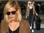 Ellie Goulding arrives at Los Angeles International Airport\nFeaturing: Ellie Goulding\nWhere: Los Angeles, California, United States\nWhen: 03 Dec 2015\nCredit: WENN.com