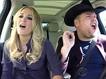 3 December 2015 - Los Angeles - USA  **** STRICTLY NOT AVAILABLE FOR USA ***  Carrie Underwood takes James Corden shopping for a cowboy outfit in Carpool Karaoke on The Late Late Show. The country singer joined Corden in his car to sing on their way to work and kicked off the journey by singing along to several of her own hits. She then suggested that Corden needed to look more 'countr'y himself, so the pair stopped off at a store where Corden tried on a pair of cowboy boots, a hat and a suede waistcoat. He was left stunned when the store clerk told him the waistcoat cost $2,000 and the boots were $800. Underwood tried to talk him into buying the boots but in the end he just took the hat, which still set him back $200. Once back in the car, the pair were singing again until Corden challenged Underwood to see who could hold a note the longest - with Corden winning as Underwood got a fit of giggles, telling him she felt like she was making the most annoying sound in the world from the m