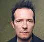"""Stone Temple Pilots' Scott Weiland Dies at 48  Weiland was also the frontman for Velvet Revolver.  Scott Weiland, the former frontman for rock bands Stone Temple Pilots and Velvet Revolver, died in Minnesota on Thursday while on tour with his current band. He was 48.   A note on Weiland's Facebook page confirmed the singer's death and said he had """"passed away in his sleep while on a tour stop in Bloomington, Minnesota, with his band The Wildabouts"""".  A California native, Weiland formed the band Stone Temple Pilots with brothers Robert and Dean DeLeo and saw huge commercial success in the 1990s. In 1993, the band?s debut album Core peaked at No. 3 on the Billboard 200 followed by an even bigger achievement a year later in 1994, when STP released the album Purple, which contained several radio hits including the songs ?Big Empty,? ?Vasoline? and ?Interstate Love Song,? at it reached No. 1."""
