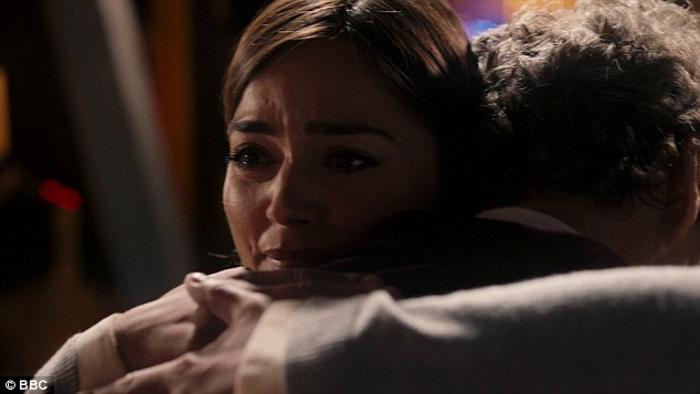One last hug: All the Doctor could say was 'Clara...' before she clung on to him in one last hug