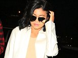 Please contact X17 before any use of these exclusive photos - x17@x17agency.com   Plump-lipped Kylie Jenner arrives at LAX airport around 6am for an early flight out of LA. The young reality tv starlet is dressed in a white pant suit with matching long white jacket, and she goes makeup free. The ensemble is in contrast to the body-hugging black and sheer dress she wore to the GQ Men of The Year party at Chateau Marmont in West Hollywood the night before. December 4, 2015 X17online.com EXCLUSIVE