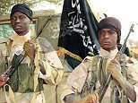 """An image released on December 7, 2015 by Al-Ribat Media Foundation, the media unit of the Mali-based jihadist organisation al-Murabitoon allegedly shows a picture of Abdul Hakim and Mu'adh al-Fulani, two fighters involved in the Radisson Blu Hotel attack in Bamako.  Al-Qaeda in the Islamic Maghreb said last month's hostage taking at a hotel in Mali's capital Bamako was a joint operation with another jihadist group, in an audio message posted Friday. / AFP / SITE Intelligence Group / HO / RESTRICTED TO EDITORIAL USE - MANDATORY CREDIT """"AFP PHOTO / SITE Intelligence Group / HO"""" - NO MARKETING NO ADVERTISING CAMPAIGNS - DISTRIBUTED AS A SERVICE TO CLIENTSHO/AFP/Getty Images"""