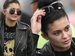 Kylie Jenner jets out of Miami airport. Wearing an 80's rocker style outfit with leather jacket and multiple piercings in her ears. Looked tired as she checked into the early morning flight after a long night partying.\n\nRef: SPL1189814  071215  \nPicture by: Splash News\n\nSplash News and Pictures\nLos Angeles: 310-821-2666\nNew York: 212-619-2666\nLondon: 870-934-2666\nphotodesk@splashnews.com\n