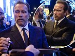 epa05057243 Former US California governor and actor Arnold Schwarzenegger signs autographs as he leaves his hotel after a meeting with French journalists in hotel in Paris on 06 December 2015. Arnold Schwarzenegger are in Paris to attend at the COP21 World Climate Change Conference 2015. The 21st Conference of the Parties (COP21) is held in Paris from 30 November to 11 December aimed at reaching an international agreement to limit greenhouse gas emissions and curtail climate change.  EPA/CHRISTOPHE PETIT TESSON