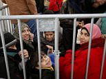 Migrants queue inside a tent at the compound outside the Berlin Office of Health and Social Affairs (LAGESO) waiting to register in Berlin, Germany, December 1, 2015.      REUTERS/Fabrizio Bensch