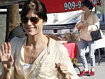 "UK CLIENTS MUST CREDIT: AKM-GSI ONLY EXCLUSIVE: Studio City, CA - Selma Blair enjoys a Sunday at the Farmer's Market. She is wearing AGL shoes ""Lace-up with bow - Christmas edition.""  Pictured: Selma Blair Ref: SPL1190894  061215   EXCLUSIVE Picture by: AKM-GSI / Splash News"