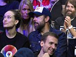Actors, from left, Olivia Wilde, Will Forte and Jason Sudeikis watch during the second half of an NBA basketball game between the Los Angeles Clippers and the Orlando Magic, Saturday, Dec. 5, 2015, in Los Angeles. The Clippers won 103-101. (AP Photo/Mark J. Terrill)