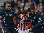 Stoke City's Spanish striker Bojan Krkic (C) is tackled by Manchester City's Argentinian defender Nicolas Otamendi (L) and Manchester City's Argentinian defender Martin Demichelis during the English Premier League football match between Stoke City and Manchester City at the Britannia Stadium in Stoke-on-Trent, central England on December 5, 2015.      AFP PHOTO / PAUL ELLIS RESTRICTED TO EDITORIAL USE. No use with unauthorized audio, video, data, fixture lists, club/league logos or 'live' services. Online in-match use limited to 75 images, no video emulation. No use in betting, games or single club/league/player publicationsPAUL ELLIS/AFP/Getty Images