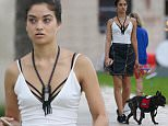 EXCLUSIVE: Australian model Shanina Shaik takes her french bulldog 'Choppa' for a walk in the park in Miami Beach, FL. Shanina, who had her sneakers untied, wore a white v-neck top with   a black skirt as she took a stroll with her service dog.\n\nPictured: Shanina Shaik\nRef: SPL1189862  041215   EXCLUSIVE\nPicture by: Pichichi / Splash News\n\nSplash News and Pictures\nLos Angeles: 310-821-2666\nNew York: 212-619-2666\nLondon: 870-934-2666\nphotodesk@splashnews.com\n