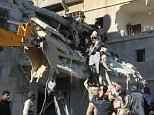 ALEPPO, SYRIA - DECEMBER 07: Syrians try to rescue people who are trapped under the rubble of a collapsed building after the war-crafts belonging to the Russian army carried out airstrikes on the opposition-controlled Sukuri neighborhood in Aleppo, Syria on December 7, 2015. (Photo by Ibrahim Ebu Leys/Anadolu Agency/Getty Images)