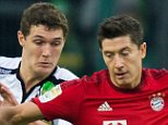 epa05055581 Moenchengladbach's Andreas Christensen (l) and Munich's Robert Lewandowski compete for the ball during the German Bundesliga football match between Borussia Moenchengladbach and Bayern Munich at the Borussia Park in Moenchengladbach, Germany, 5 December 2015.  (EMBARGO CONDITIONS - ATTENTION: Due to the accreditation guidelines, the DFL only permits the publication and utilisation of up to 15 pictures per match on the internet and in online media during the match.)  EPA/BERND THISSEN