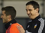 VALENCIA, SPAIN - DECEMBER 07:  Gary Neville (R) the new manager of Valencia CF reacts to his player Jose Gaya during a training session ahead of Wednesday's UEFA Champions League Group H match against Olympique Lyonnais at Paterna Training Centre on December 07, 2015 in Valencia, Spain.  (Photo by Manuel Queimadelos Alonso/Getty Images)