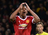 Manchester United's French striker Anthony Martial (C) reacts after missing a goal scoring opportunity during the English Premier League football match between Manchester United and West Ham United at Old Trafford in Manchester, north west England, on December 5, 2015.  AFP PHOTO / OLI SCARFF..RESTRICTED TO EDITORIAL USE. No use with unauthorized audio, video, data, fixture lists, club/league logos or 'live' services. Online in-match use limited to 75 images, no video emulation. No use in betting, games or single club/league/player publications.OLI SCARFF/AFP/Getty Images