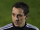 VALENCIA, SPAIN - DECEMBER 07:  Gary Neville (R) the new manager of Valencia CF talks to Valencia CF assistant Phil Neville during a training session ahead of Wednesday's UEFA Champions League Group H match against Olympique Lyonnais at Paterna Training Centre on December 07, 2015 in Valencia, Spain.  (Photo by Manuel Queimadelos Alonso/Getty Images)
