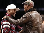Floyd Mayweather, Jr., left, greets boxer Peter Quillin in the first half of an NBA basketball game between the Brooklyn Nets and the Phoenix Suns at the Barclays Center, Tuesday, Dec. 1, 2015, in New York. (AP Photo/Kathy Willens)