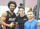 David Haye poses with Shane McGuigan and Carl Frampton in the gym