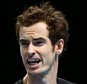 LONDON, ENGLAND - NOVEMBER 20:  A dejected Andy Murray of Great Britain reacts during the men's singles match against Stan Wawrinka of Switzerland on day six of the Barclays ATP World Tour Finals at the O2 Arena on November 20, 2015 in London, England.  (Photo by Clive Brunskill/Getty Images)