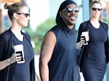 Paige Butcher shows off growing baby bump with Eddie Murphy during coffee run at Coffee Bean in Studio City on Monday.\n\nPictured: Eddie Murphy, Paige Butcher\nRef: SPL1190806  071215  \nPicture by: INTERSTAR/SPLASH\n\nSplash News and Pictures\nLos Angeles: 310-821-2666\nNew York: 212-619-2666\nLondon: 870-934-2666\nphotodesk@splashnews.com\n