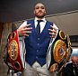 Boxing - Tyson Fury - WBA, IBF, WBO & IBO Heavyweight Champion Homecoming Press Conference - The Whites Hotel, Macron Stadium, Bolton - 30/11/15\n Tyson Fury poses with his belts after the press conference\n Action Images via Reuters / Alex Morton\n Livepic\n EDITORIAL USE ONLY.