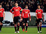 (L-R) Manchester United's Michael Carrick, Chris Smalling, Nick Powell and Cameron Borthwick-Jackson stand dejected after the final whistle
