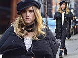 """MUST BYLINE: EROTEME.CO.UK Model and actress Suki Waterhouse is seen listening to some tunes on her earphones in Manhattan where she is filming """"The Girl Who invented Kissing"""" EXCLUSIVE   December 7, 2015 Job: 151207L1    New York, New York EROTEME.CO.UK 44 207 431 1598 Ref: 341629"""