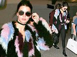 Kendall Jenner arriving in funky fur from London with Lionel Richie  who was possibly on the same flight as the model/reality star December 8, 2015  X17online.com