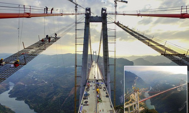 Chinese engineers put finishing touches to huge suspension bridge in China