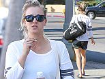 Picture Shows: Kaley Cuoco  December 07, 2015    Kaley Cuoco spotted leaving Sweet & Butter in Sherman Oaks, California.     'The Big Bang Theory' star recently removed her wedding anniversary tattoo, which was located on the back.     Exclusive - All Round  UK RIGHTS ONLY    Pictures by : FameFlynet UK © 2015  Tel : +44 (0)20 3551 5049  Email : info@fameflynet.uk.com