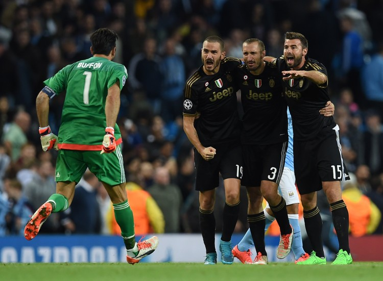 (L-R) Juventus' goalkeeper from Italy Gianluigi Buffon, Juventus' defender from Italy Leonardo Bonucci, Juventus' defender from Italy Giorgio Chiellini and Juventus' defender from Italy Andrea Barzagli celebrate after winning a UEFA Champions League group stage football match between Manchester City and Juventus at the Etihad stadium in Manchester, north-west England on September 15, 2015.   AFP PHOTO / PAUL ELLIS