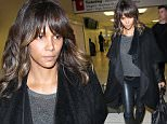 Los Angeles, CA - A makeup free Halle Berry arrives at LAX Airport, along with her bodyguard. Berry and Martinez, her third husband, met on the set of the movie Dark Tide in 2010. The actress filed papers to end their two-year marriage on Oct. 26 and later refiled the documents.\n  \nAKM-GSI       December 9, 2015\nTo License These Photos, Please Contact :\nSteve Ginsburg\n(310) 505-8447\n(323) 423-9397\nsteve@akmgsi.com\nsales@akmgsi.com\nor\nMaria Buda\n(917) 242-1505\nmbuda@akmgsi.com\nginsburgspalyinc@gmail.com