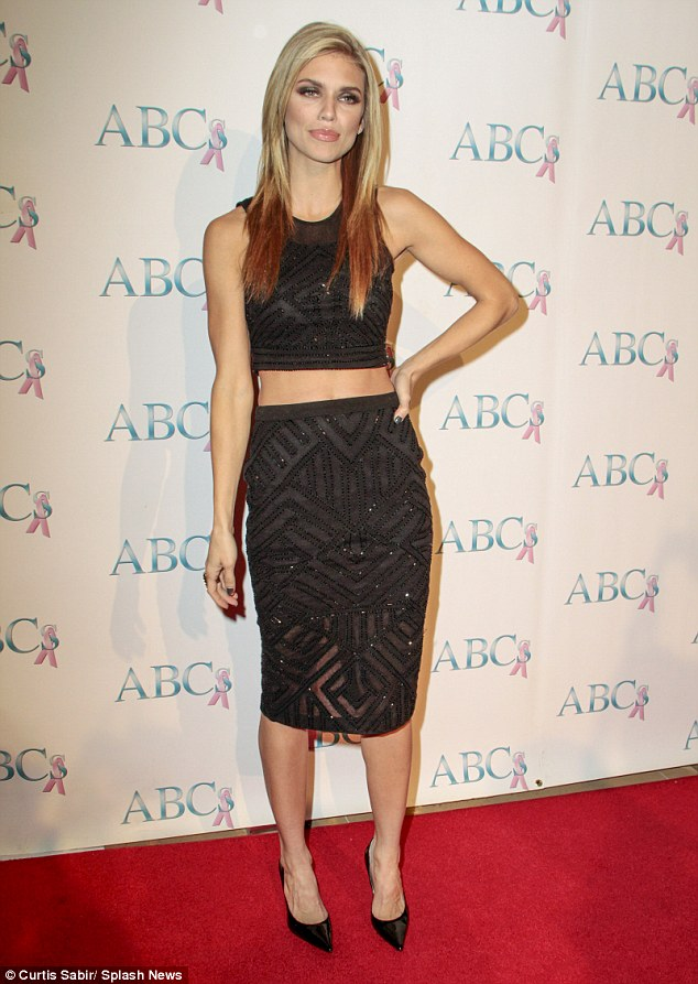 Back in the spotlight:Former 90210 Star AnnaLynne McCord made a sexy statement by flashing her toned tummy on the red carpet for a charity event on Saturday