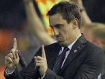 Valencia's British coach Gary Neville gestures from the sidelines during the UEFA Champions League football match Valencia CF vs Olympique Lyonnais at the Mestalla stadium in Valencia on December 9, 2015.   AFP PHOTO/ JOSE JORDANJOSE JORDAN/AFP/Getty Images